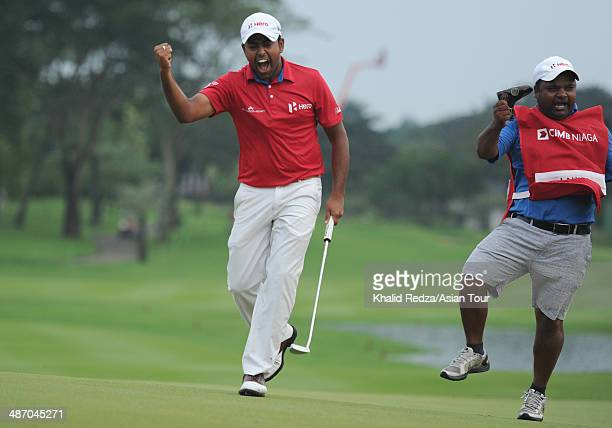 Anirban Lahiri Lahiri of India in screams in delight with his caddie Rajiv Sharma after winning his first title outside India of the CIMB Niaga...