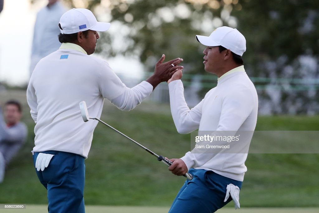 Anirban Lahiri of India and the International Team and Si Woo Kim of South Korea and the International Team celebrate on the 17th green during Saturday four-ball matches of the Presidents Cup at Liberty National Golf Club on September 30, 2017 in Jersey City, New Jersey.