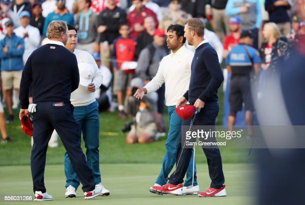 Anirban Lahiri of India and the International Team and Si Woo Kim of South Korea and the International Team shake hands with Charlie Hoffman and...