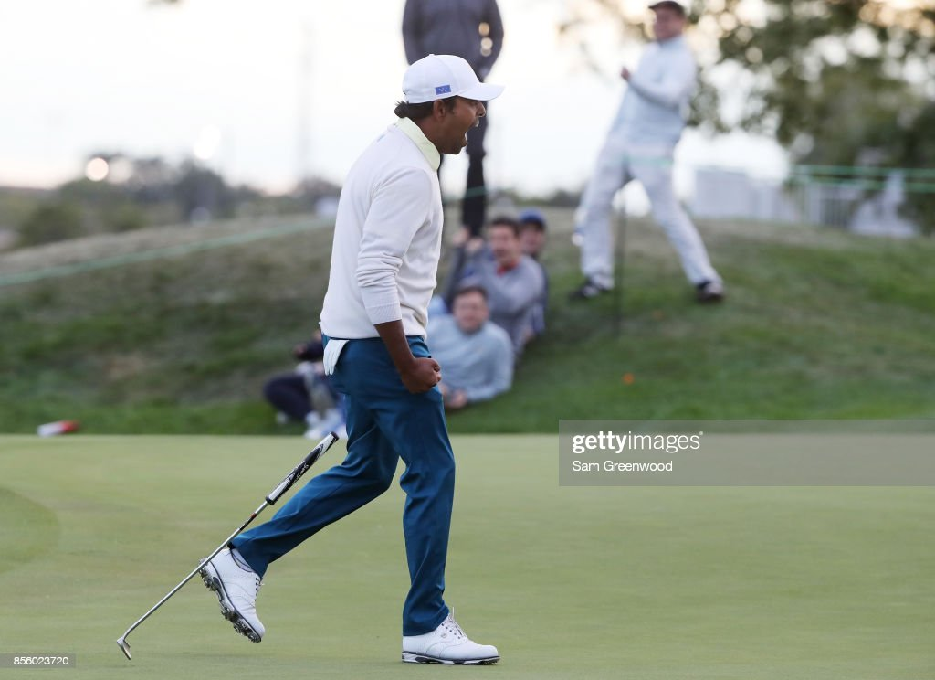 Anirban Lahiri of India and the International Team celebrates on the 17th green during Saturday four-ball matches of the Presidents Cup at Liberty National Golf Club on September 30, 2017 in Jersey City, New Jersey.