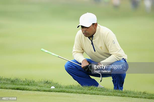 Anirban Lahiri of India and the International Team lines up a putt on the second green during the Sunday singles matches at The Presidents Cup at...