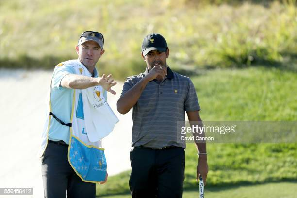 Anirban Lahiri of India and the International team on the 14th hole in his match against Kevin Kisner during the final day singles matches matches in...