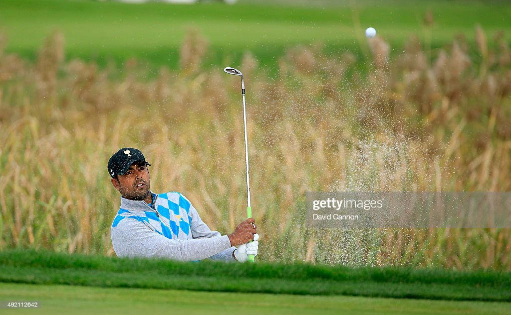 Anirban Lahiri of India and the International team plays his third shot at the 11th hole in his match with Adam Scott against Zach Johnson and Phil Mickelson of the United States team during the Saturday afternoon fourball matches at The Presidents Cup at Jack Nicklaus Golf Club Korea on October 10, 2015 in Songdo IBD, Incheon City, South Korea.