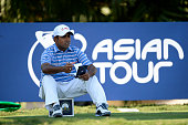 Anirban Lahiri of India checks his yardage during the ProAm for the Thailand Golf Championship at Amata Spring Country Club on December 10 2014 in...