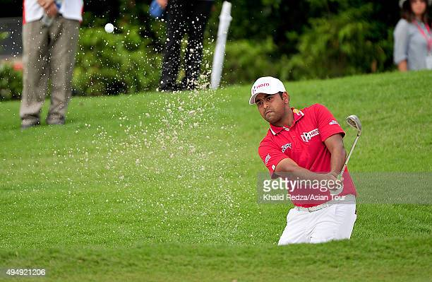 Anirban Lahiri of India plays a shot during round two of the CIMB Classic at Kuala Lumpur Golf Country Club on October 30 2015 in Kuala Lumpur...