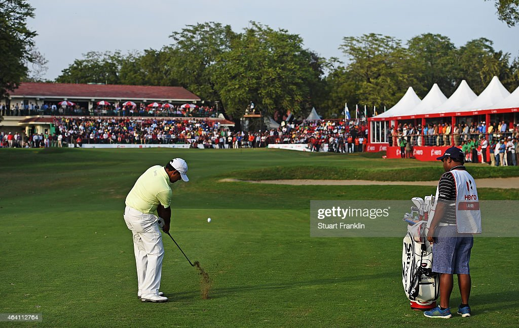 Anirban Lahiri of India plays his approach shot on the 18th hole during the playoff against S.S.P Chawrasia of India during the final round of the Hero India Open Golf at Delhi Golf Club on February 22, 2015 in New Delhi, India.
