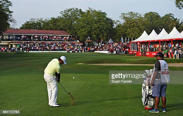 Anirban Lahiri of India plays his approach shot on the 18th hole during the playoff against SSP Chawrasia of India during the final round of the Hero...