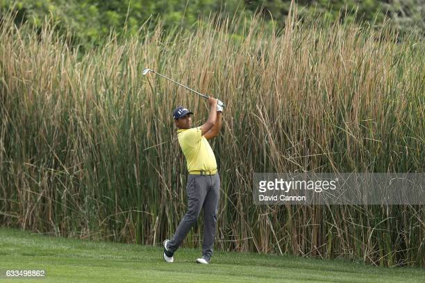 Anirban Lahiri of India plays his second shot on the par 4 ninth hole during the first round of the 2017 Omega Dubai Desert Classic on the Majlis...