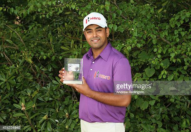 Anirban Lahiri of India poses with his European Tour Golfer of the Month for February award during day 1 of the BMW PGA Championship at Wentworth on...