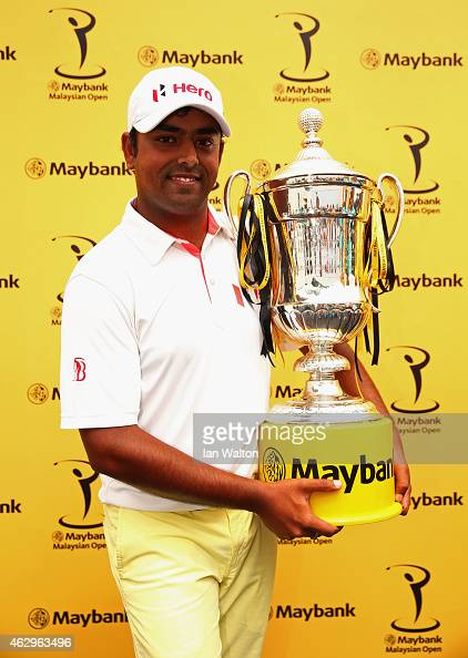 Anirban Lahiri of India poses with the trophy after victory during the final round of the Maybank Malaysian Open at Kuala Lumpur Golf Country Club on...