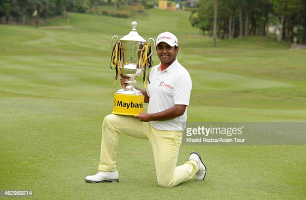 Anirban Lahiri of India posing with the trophy after winning during round four of the Maybank Malaysian Open at Kuala Lumpur Golf Country Club on...