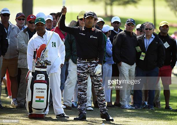Anirban Lahiri of India pulls a club from his bag as he prepares to play a shot on the third hole during the third round of the 2016 Masters...