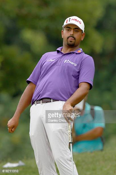Anirban Lahiri of India reacts on the 13th hole after missing a birdie during day three of the 2016 CIMB Classic at Kuala Lumpur Golf Country Club on...