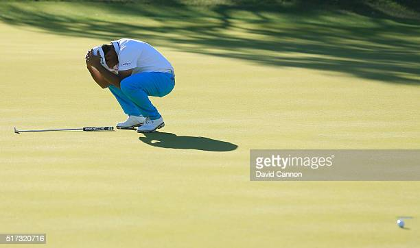 Anirban Lahiri of India reacts to a missed birdie putt on the 18th green during the second round of the World Golf ChampionshipsDell Match Play at...