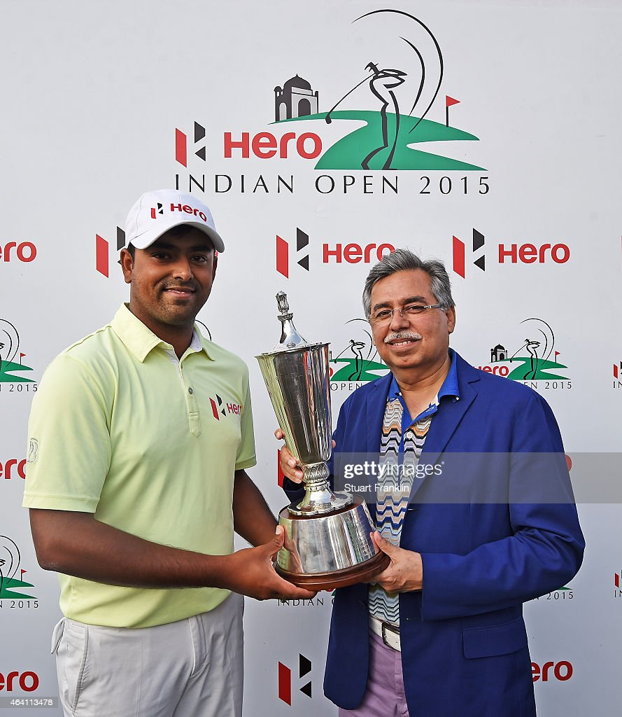 Anirban Lahiri of India recieves the winners trophy from Pawan Munjal, Managing director and CEO of Hero MotoCorp after the Hero India Open Golf at Delhi Golf Club on February 22, 2015 in New Delhi, India.