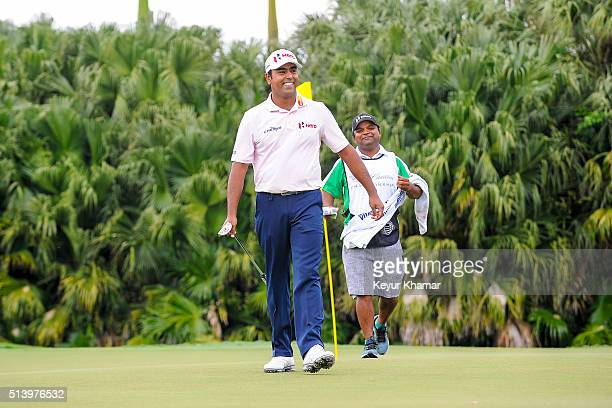 Anirban Lahiri of India smiles on the 13th hole green during the third round of the World Golf ChampionshipsCadillac Championship at Blue Monster...