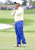 Anirban Lahiri of the International Team reacts after a putt on the 18th hole during the Sunday singles matches at The Presidents Cup at Jack...