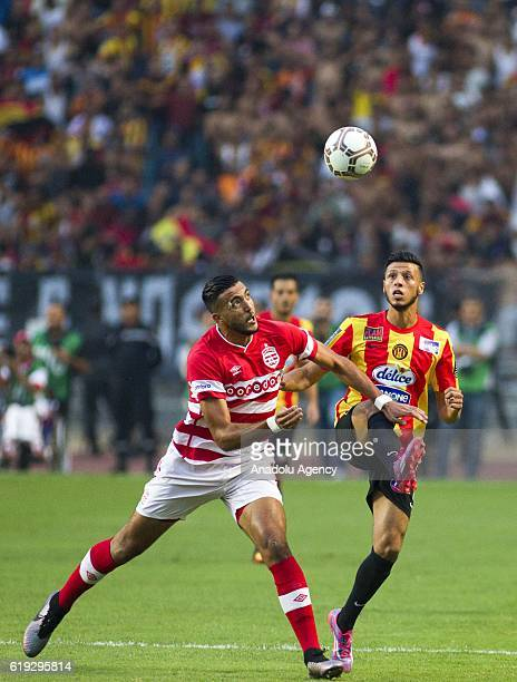 Anis Badri of Esperance Sportive in action against Nader Ghandri of Club Africain during the Tunisian Professional League 1 football match between...