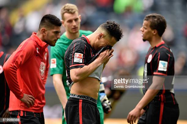 Anis BenHatira of Eintracht Frankfurt and team mates look dejected after the Bundesliga match between Eintracht Frankfurt and 1899 Hoffenheim at...