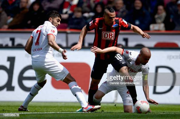 Anis BenHatira of Hertha BSC Berlin is challenged by Miso Brecko of 1 FC Koeln during the Second Bundesliga match between 1 FC Koeln and Hertha BSC...