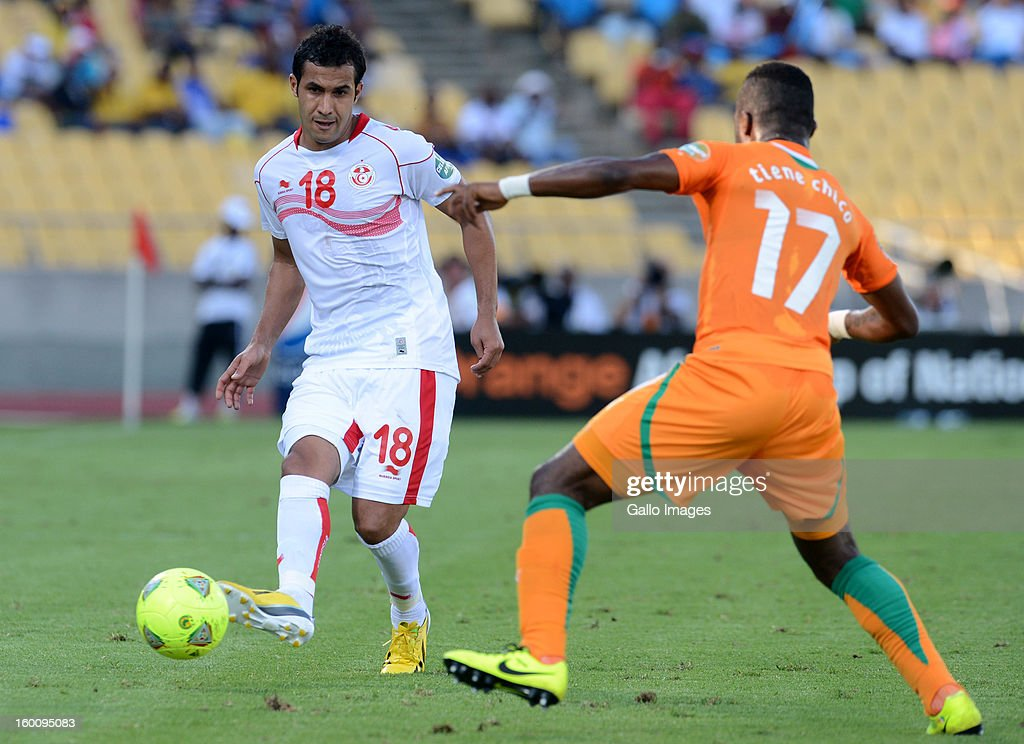 Anis Boussaidi of Tunisia and Tiene Chico of Ivory Coast (R) during the 2013 African Cup of Nations match between Ivory Coast and Tunisia at Royal Bafokeng Stadium on January 26, 2013 in Rustenburg, South Africa.