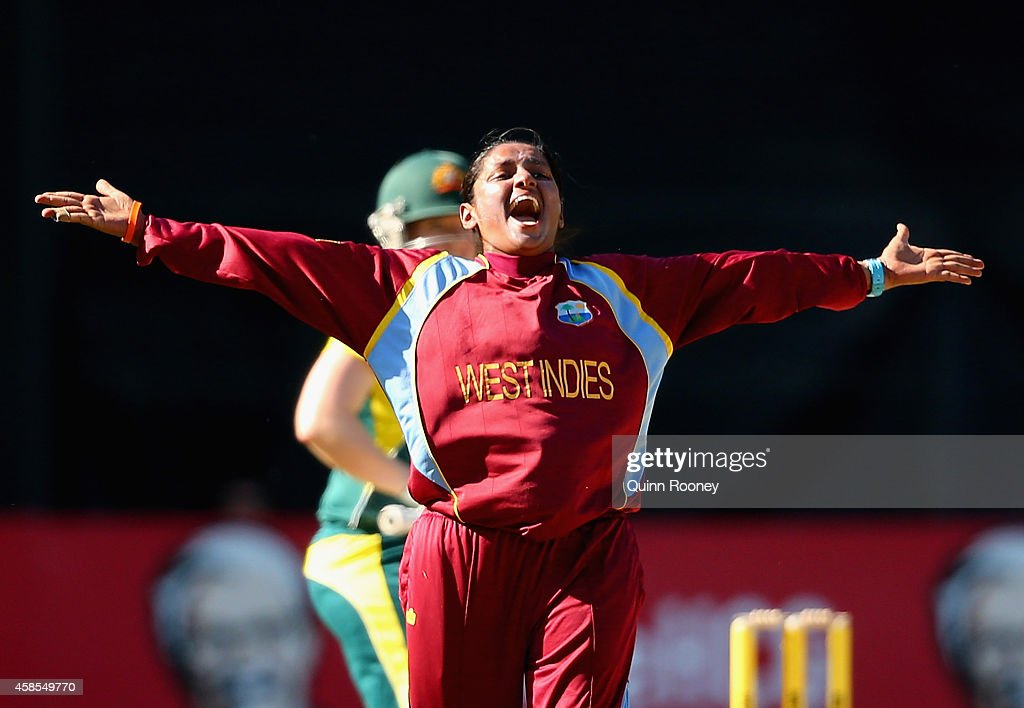<a gi-track='captionPersonalityLinkClicked' href=/galleries/search?phrase=Anisa+Mohammed&family=editorial&specificpeople=5434814 ng-click='$event.stopPropagation()'>Anisa Mohammed</a> of the West Indies celebrates the wicket of <a gi-track='captionPersonalityLinkClicked' href=/galleries/search?phrase=Jess+Cameron+-+Cricketspeler&family=editorial&specificpeople=12709381 ng-click='$event.stopPropagation()'>Jess Cameron</a> of Australia during game three of the International Women's Twenty20 match between Australia and the West Indies at Melbourne Cricket Ground on November 7, 2014 in Melbourne, Australia.