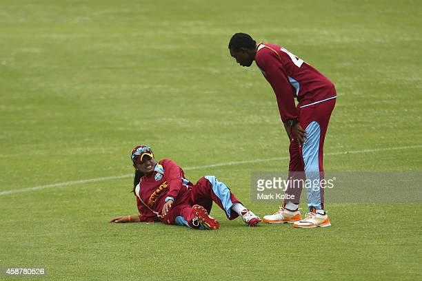 Anisa Mohammed of the West Indies lies injured on the ground during game one of the women's One Day International series between Australia and the...