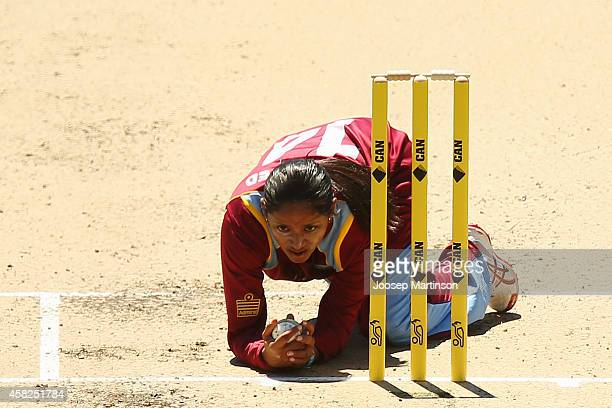 Anisa Mohammed of West Indies bowls and takes a catch to dismiss Ellyse Perry of Australia during the women's International Twenty20 match between...