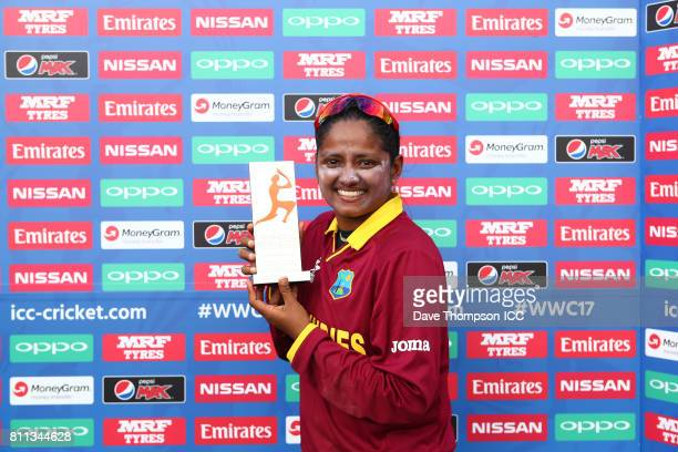 Anisa Mohammed of West Indies is presented with the Player of the Match award during the ICC Women's World Cup match between West Indies and Sri...