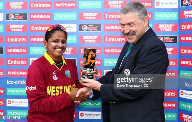Anisa Mohammed of West Indies is presented with the Player of the Match award by match referee David Jukes during the ICC Women's World Cup match...