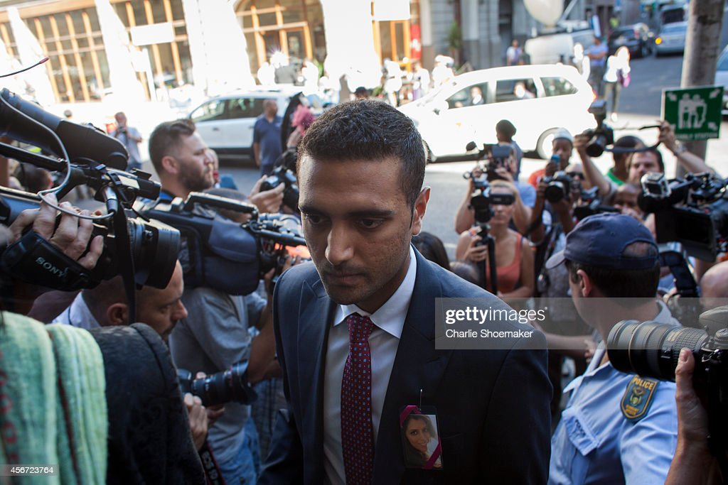 Anish Hindocha, the brother of <a gi-track='captionPersonalityLinkClicked' href=/galleries/search?phrase=Anni+Dewani&family=editorial&specificpeople=7343601 ng-click='$event.stopPropagation()'>Anni Dewani</a>, arrives at the Western Cape High Court for the start of the trial of Shrien Dewani on October 6, 2014 in Cape Town, South Africa. British businessman Shrien Dewani, who fought an extradition battle for three years, is accused of arranging the murder of his new wife in 2010, just days after their marriage. A South African taxi driver and two accomplices are serving prison sentences for their connection with the murder of Mrs Dewani.