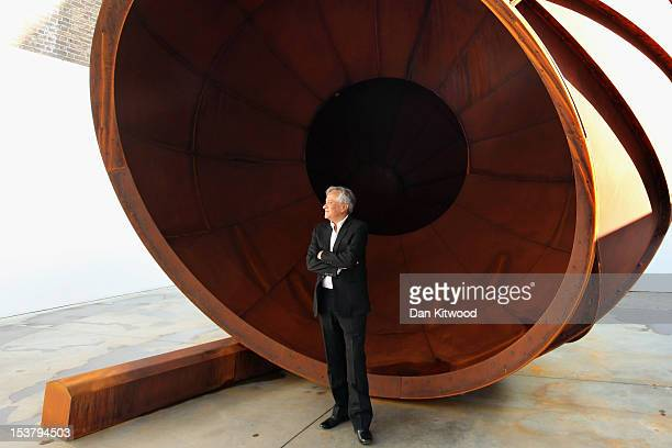 Anish Kapoor poses in front of a piece of his work entitled 'Intersection' during a press preview at the Lisson Gallery on October 9 2012 in London...
