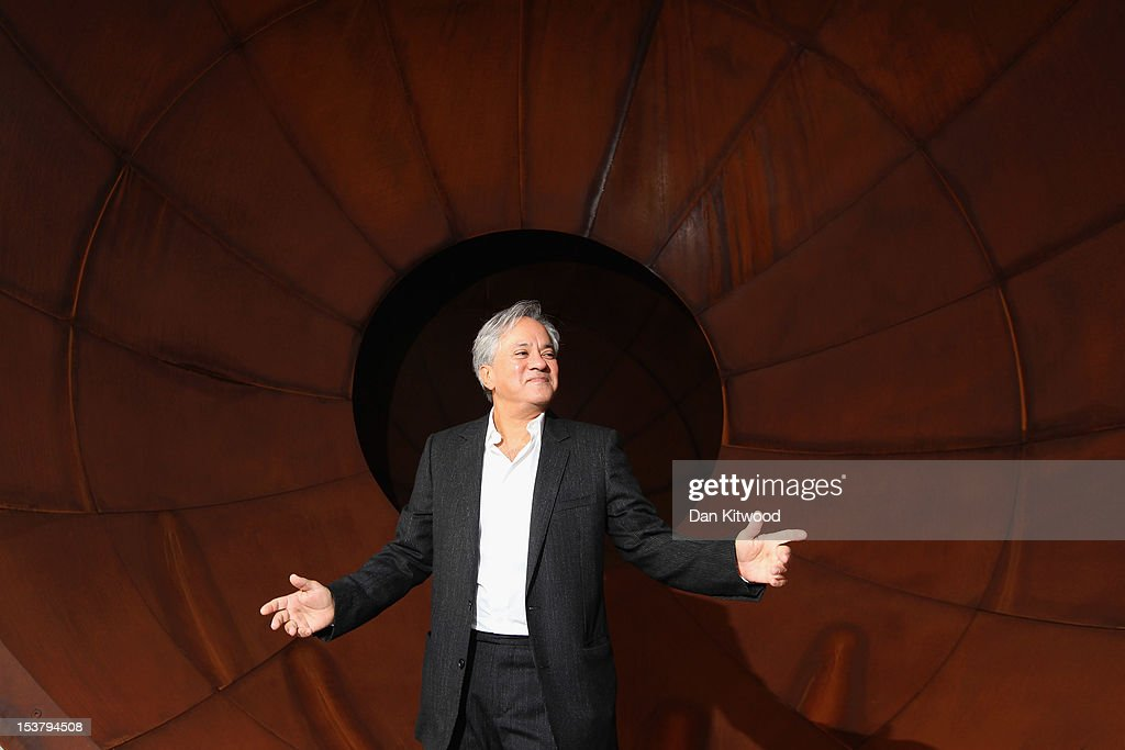 <a gi-track='captionPersonalityLinkClicked' href=/galleries/search?phrase=Anish+Kapoor&family=editorial&specificpeople=3965986 ng-click='$event.stopPropagation()'>Anish Kapoor</a> poses in front of a piece of his work entitled 'Intersection' during a press preview at the Lisson Gallery on October 9, 2012 in London, England. The solo exhibition celebrates 30 years of the Lisson Gallery and its ongoing collaboration with the Turner Prize winning artist to showcase a large selection of his recent work. The exhibition runs at the gallery until November 10, 2012.