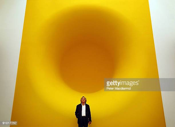 Anish Kapoor stands with his sculpture entitled 'Yellow' at The Royal Academy on September 22 2009 in London The Anish Kapoor exhibition runs from...