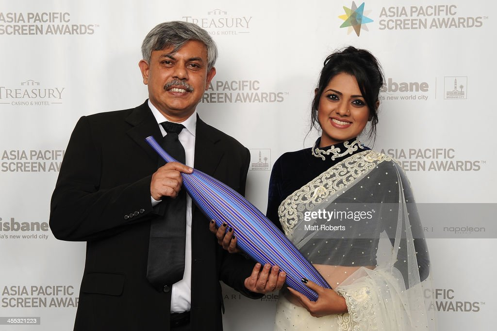 Anisul Hoque and Nusrat Imroz Tisha pose for a portrait during the Asia Pacific Screen Awards (APSA) at Brisbane City Hall on December 12, 2013 in Brisbane, Australia.