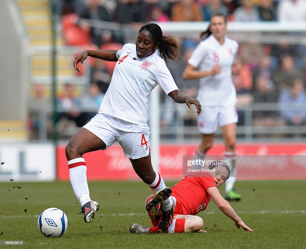 <a gi-track='captionPersonalityLinkClicked' href=/galleries/search?phrase=Anita+Asante&family=editorial&specificpeople=2392102 ng-click='$event.stopPropagation()'>Anita Asante</a> of England is challenged by <a gi-track='captionPersonalityLinkClicked' href=/galleries/search?phrase=Diana+Matheson&family=editorial&specificpeople=2473518 ng-click='$event.stopPropagation()'>Diana Matheson</a> of Canada during the Women's International Match between England Women and Canada Women at The New York Stadium on April 7, 2013 in Rotherham, England.
