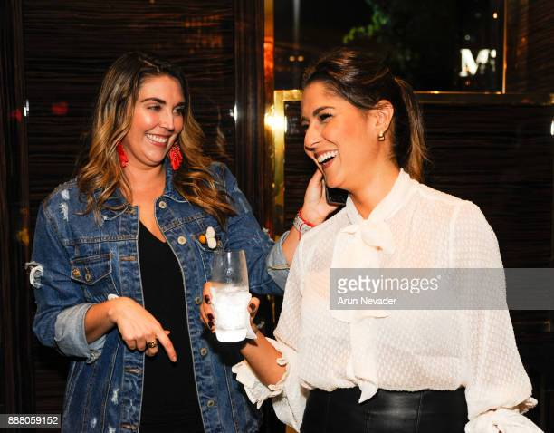 Anita Autiero and Maria Chating enjoy a moment during the cocktail reception at Vagu on December 7 2017 in Miami Florida