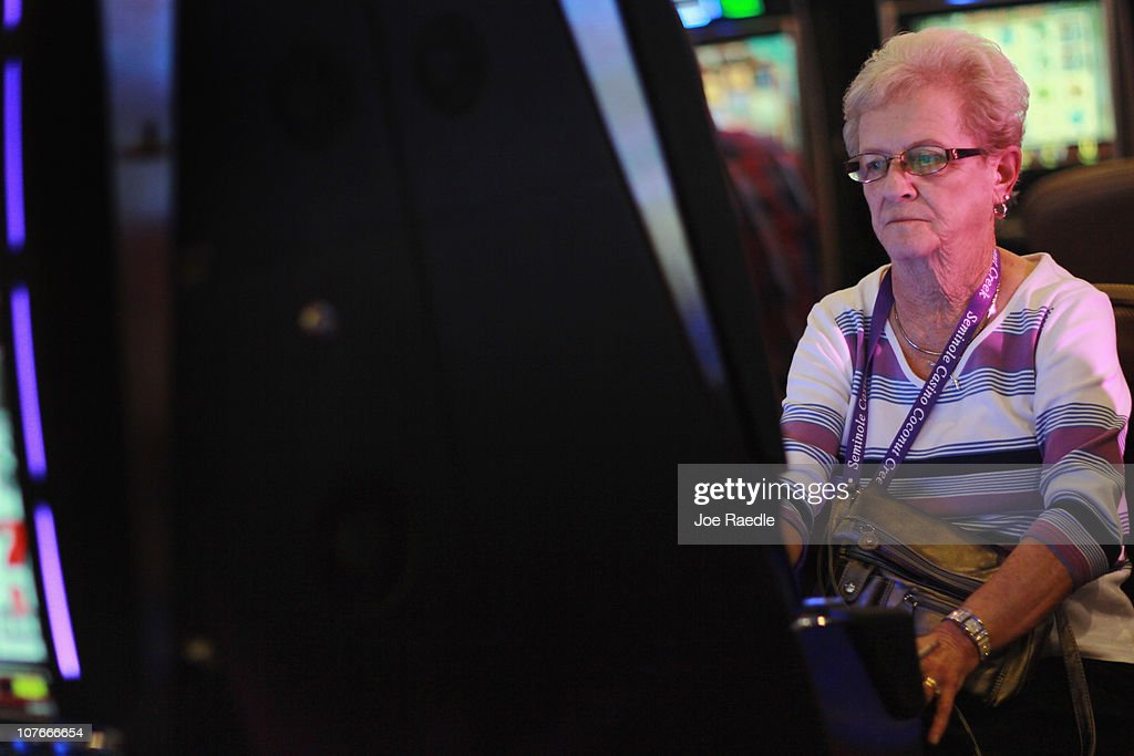 Anita Binnall plays a slot machine during the grand opening of the newest building at the Seminole Casino Coconut Creek on December 17, 2010 in Coconut Creek, Florida. The site offers up an additional 400-plus gaming positions, a new restaurant and a new venue with more space to gamble, dine and party.