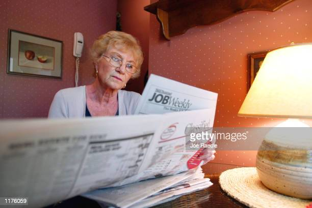 Anita Dante in her late 60's searches for a job in a local newspaper's classified section at her home July 26 2002 in Margate Florida After working...