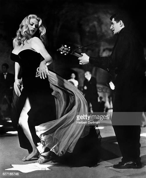 Anita Ekberg dances in a scene from the Fellini film La Dolce Vita