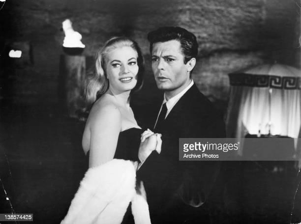 Anita Ekberg holding the hands of Marcello Mastroianni in a scene from the film 'La Dolce Vita' 1960