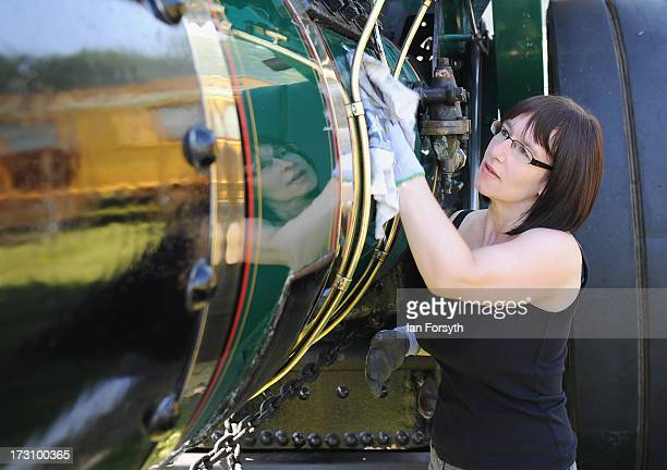Anita Ellis from Dalton polishes her steam engine 'The Maori' at the steam rally at Duncombe Park on July 7 2013 in Helmsley England The popular...
