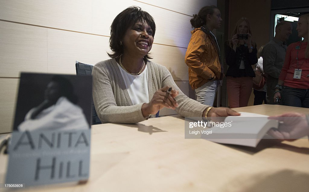 <a gi-track='captionPersonalityLinkClicked' href=/galleries/search?phrase=Anita+Hill&family=editorial&specificpeople=655733 ng-click='$event.stopPropagation()'>Anita Hill</a> signs copies of her books during Anita, NEW VIEWS Documentaries & Dialogue, co-presented by the Aspen Institute Arts Program and Aspen Film at the Paepke Auditorium at the Aspen Institute on July 29, 2013 in Aspen, Colorado.