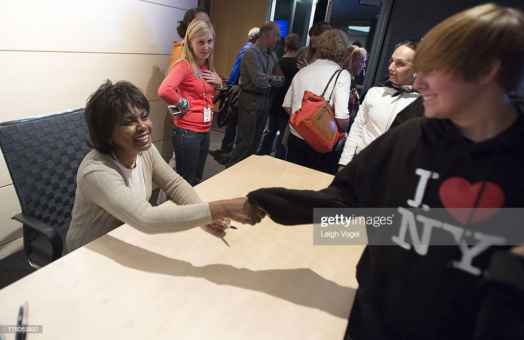 Anita Hill signs copies of her books during Anita, NEW VIEWS Documentaries & Dialogue, co-presented by the Aspen Institute Arts Program and Aspen Film at the Paepke Auditorium at the Aspen Institute on July 29, 2013 in Aspen, Colorado.