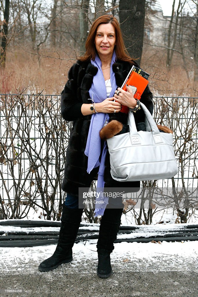 Anita Hyzy wearing Gucci scarf, Chanel bag, Hermes ipad case attends Mercedes-Benz Fashion Week Autumn/Winter 2013/14 at venue on January 15, 2013 in Berlin, Germany.
