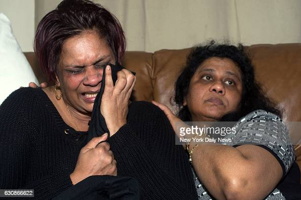 Anita Kalisaranleft clutches her son's shirt as she cries repeatedly 'They killed my son they killed my baby' as she mourns the death of her son...