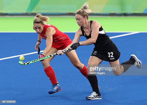 Anita McLaren of New Zealand is challenged by Susannah Townsend during the Women's hockey semi final match betwen New Zealand and Great Britain on...