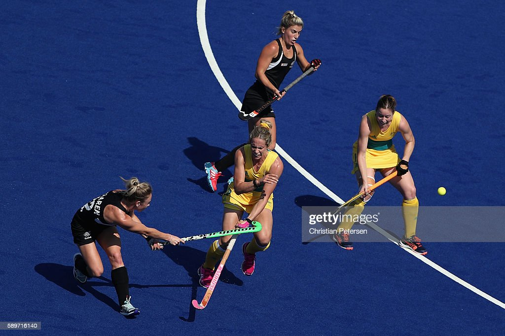 Anita Mclaren of New Zealand shoots the ball past Madonna Blyth of Australia during the quarter final hockey game on Day 10 of the Rio 2016 Olympic...