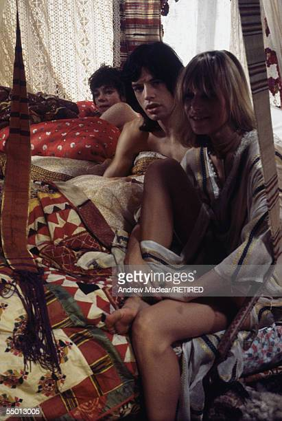 Anita Pallenberg and Mick Jagger with French actress Michele Breton on the set of Donald Cammell and Nicolas Roeg's psychological thriller...