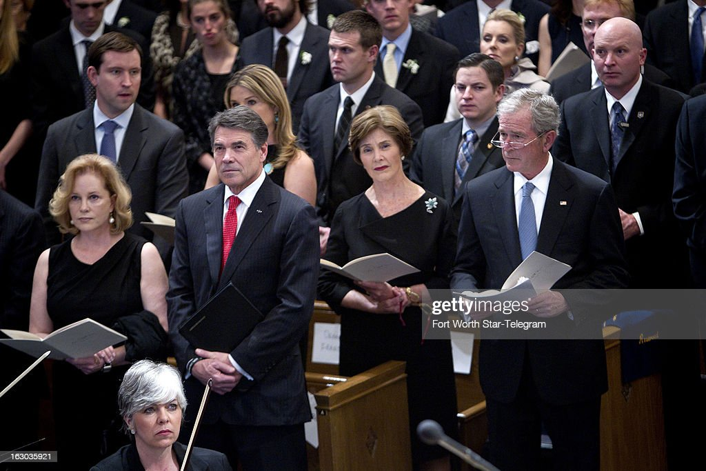 Anita Perry and Texas Gov. Rick Perry, and Laura and former president George W. Bush attend the funeral service for Van Cliburn at Broadway Baptist Church in Fort Worth, Texas, Sunday, March 3, 2013.